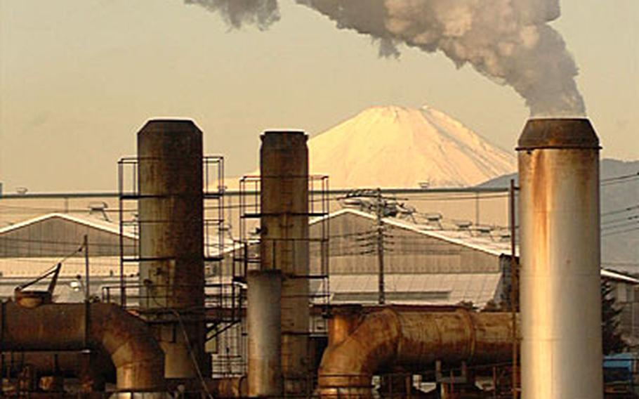 Smoke from the Enviro-tech incinerator blows toward Atsui Naval Air Facility's housing areas Saturday, with a snow-covered Mount Fuji in the background.