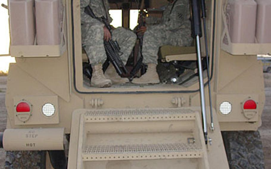 A pair of soldiers inside a new Mine-Resistant Ambush Protected (MRAP) vehicle at Camp Liberty in Baghdad.