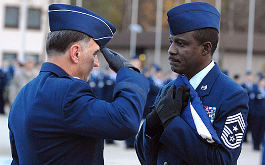 Gen William T. Hobbins, U.S. Air Forces in Europe commander, salutes the flag after presenting it to USAFE Command Chief Master Sgt. Gary G. Coleman during a retreat ceremony. The retreat ceremony followed a retirement ceremony honoring Coleman for 30 years of military service.