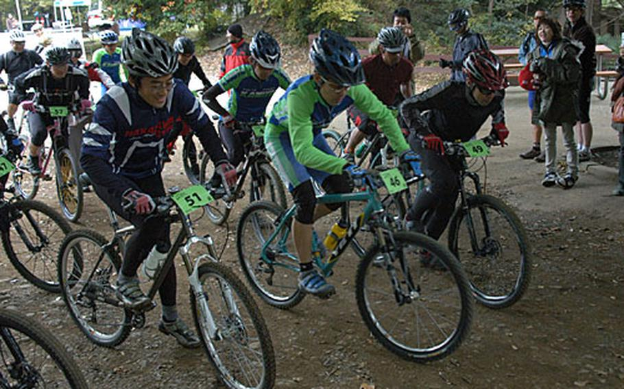 The Expert Division race gets under way Saturday during the 20th Tour de Tama Mountain Bike Race at Tama Hills Recreation Center, Japan.