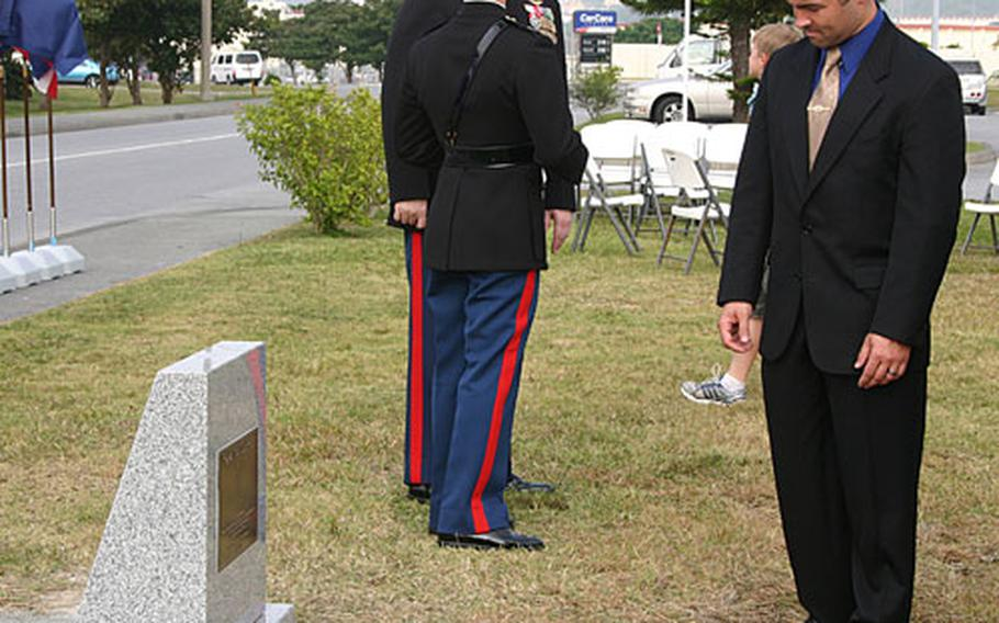 Rayme Brock looks at the memorial plaque dedicated to his twin brother, Capt. Sean L. Brock, after a ceremony on Camp Foster that renamed the street in front of the plaque for his brother. Capt. Sean L.