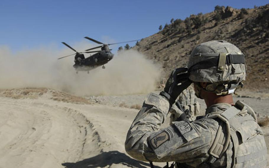 A soldier with the 173rd Airborne Brigade watches as a U.S. Army Chinook helicopter carrying Afghan national legislators touches down near a meeting in the rugged country's eastern mountains. The shura, as it is called, was attended by Afghan mullahs, imams, parliamentarians and Paktika provincial leaders. Security was heavy, with more than 20 U.S. Army snipers posted on the mountaintops surrounding the meeting.