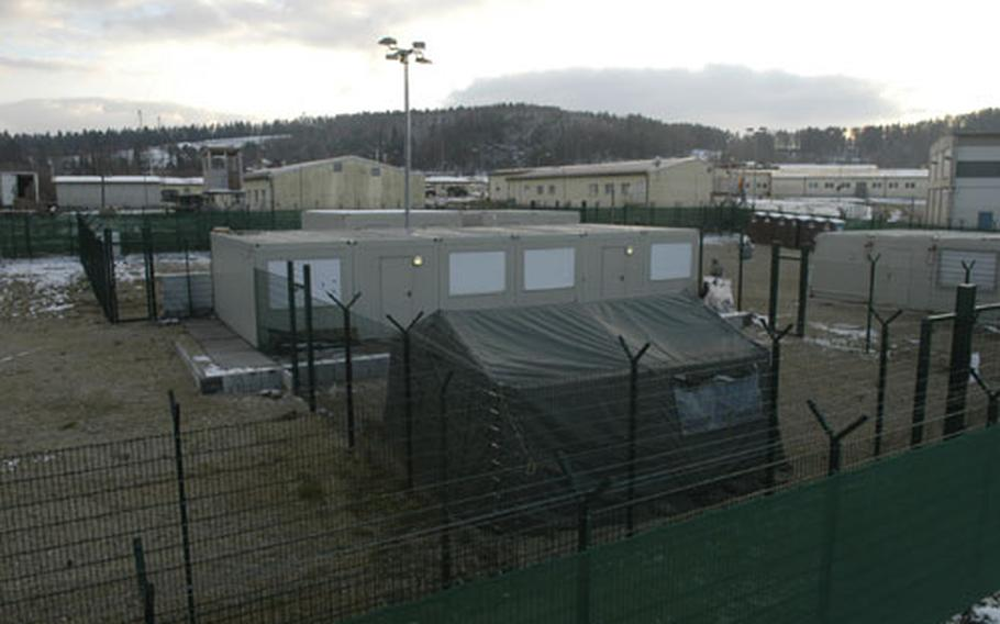 Holding cells, watchtowers and barbed wire are part of the set-up aimed at creating the feel of an actual detainee camp, at the Joint Multinational Readiness Center in Hohenfels, Germany.