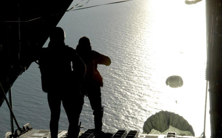321st Special Tactics Squadron airmen jump out of an MC-130P Combat Shadow into a blinding ray of sunshine as part of a training exercise over the North Sea.