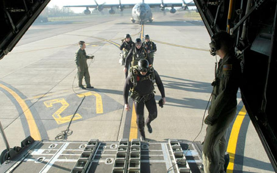 Wetsuit-clad members of the 321st Special Tactics Squadron load into an MC-130P Combat Shadow as part of a training exercise over the North Sea.
