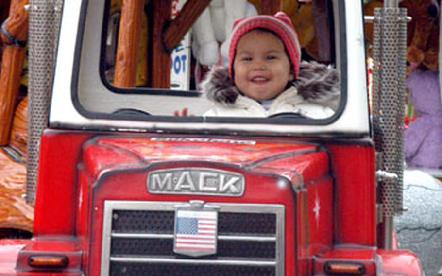 Ann Marie Johnson, 2, enjoys a ride Saturday at RAF Mildenhall's annual holiday bazaar.