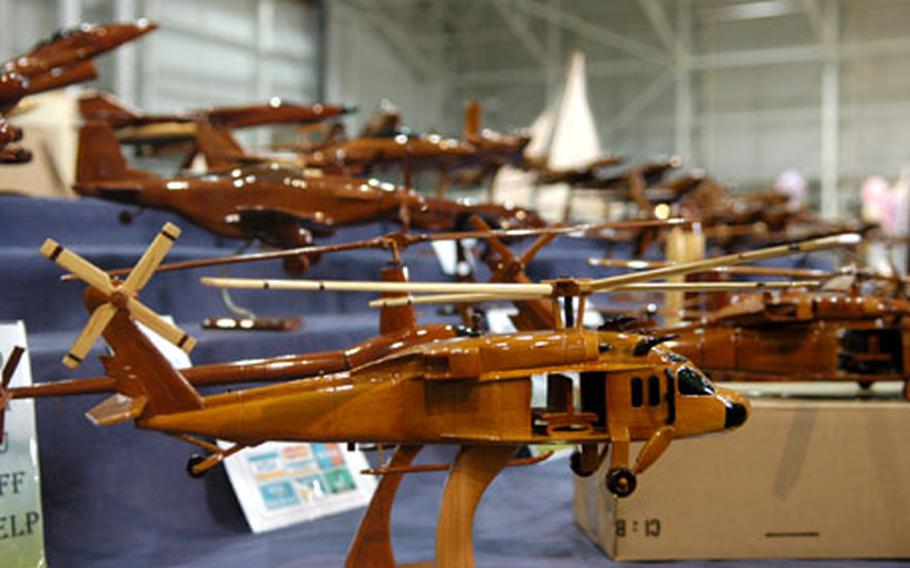 Among the more Air Force-centric offerings at last weekend's RAF Mildenhall bazaar were a variety of mahogany sculpted aircraft models being sold by the British company Unique Natural Wood.