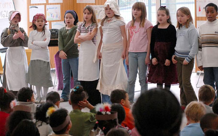 Students of Dexheim Elementary School's third- and fourth-grade classes sing a Thanksgiving song Wednesday at the conclusion of the school's holiday celebration.