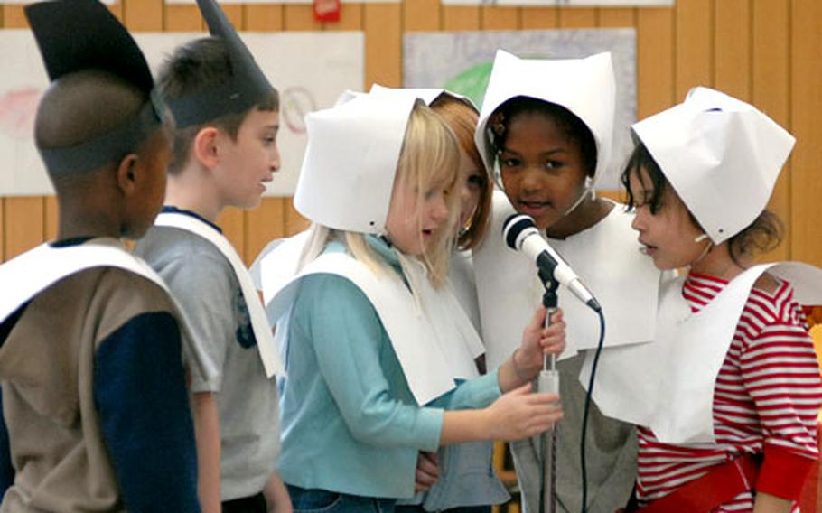 First-grade Pilgrims say their lines during the third- and fourth-grade classes' performance at the Dexheim Elementary School's Thanksgiving celebration Wednesday in Dexheim, Germany. From left to right are Daniel Wright, Robert Gochenour, Alexis Paprzycki, Annika Hogland, Iam Hammock and Stephania Suarez. It is the final Thanksgiving for the school, which is scheduled to close at the end of the school year.