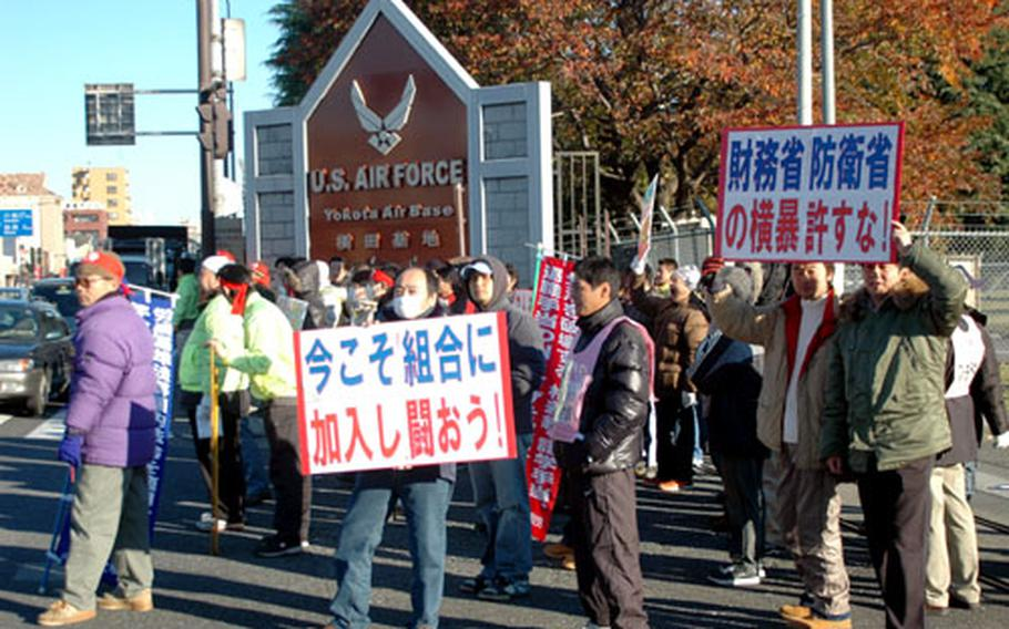 Japanese base employees stand outside Yokota Air Base's main gate during a four-hour strike Wednesday morning.