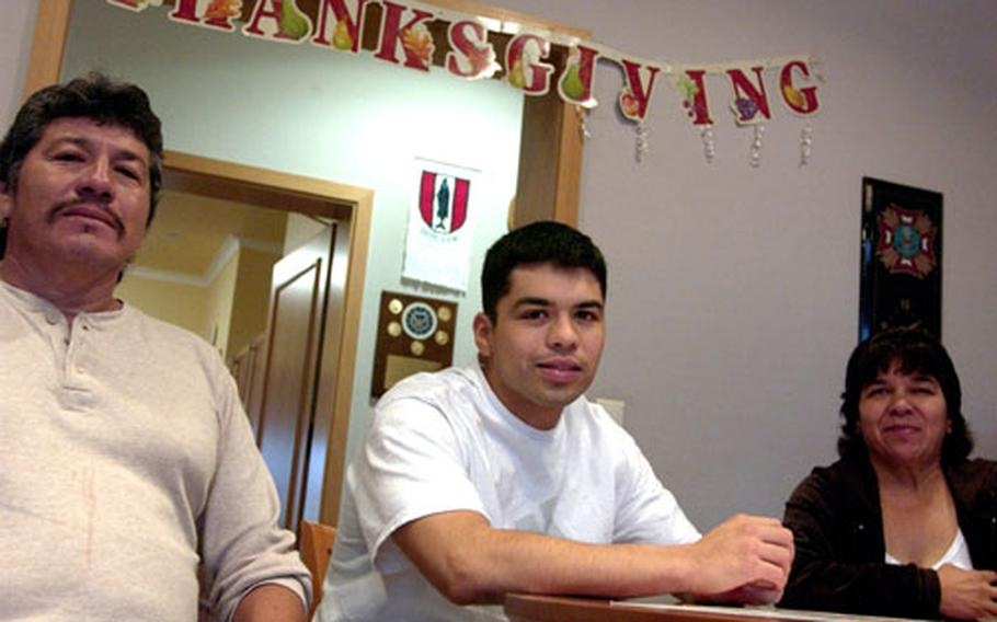Army Staff Sgt. Josue Valles (center) and his parents, Jose and Felicitas Valles, spent Thanksgiving at the Fisher House on the grounds of Landstuhl Regional Medical Center. The family has been staying at the house for several weeks after Valles was wounded in Afghanistan in October.