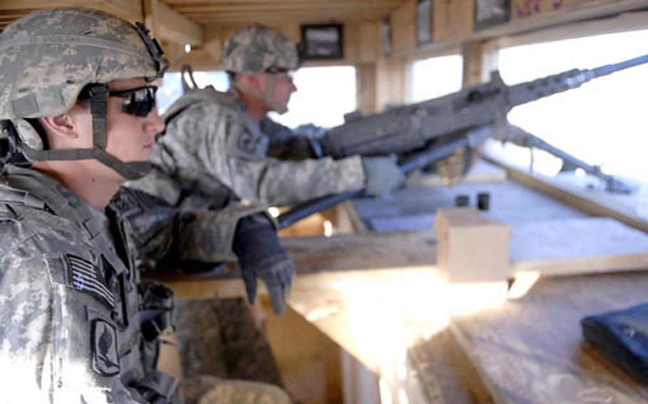 Pfc. Raymond Cabrera (left), 22, from the Bronx, sits watch in a guard tower with Sgt. Kristopher Hollan, 27, of Sacramento, Calif. Both men, of the 173rd Airborne Brigade's 1st Battalion, 503rd Infantry Regiment, spent Thanksgiving keeping an eye out for Taliban insurgents. Two fellow soldiers were killed last week by a roadside bomb.