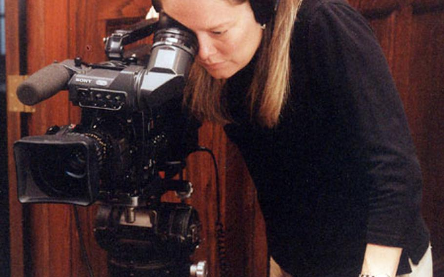 """Filmmaker Donna Musil works on her documentary """"Brats: Our Journey Home"""" in this undated photo."""