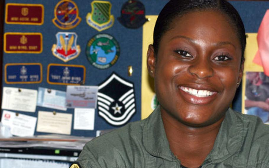 Technical Sgt. Mimi Byrd, an airspace physiology technician with 18th Aerospace Medicine Squadron, recently learned that she was selected to become a Medical Services Corps officer. Behind her at her desk she keeps her goals on display: pictures of her young daughter and her husband as well as the insignia of the two ranks she was striving to achieve next.