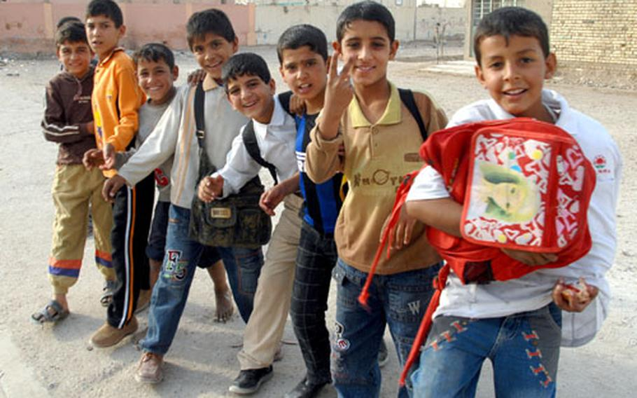 Children in Abu T'Shir, Baghdad, asked for sweets and soccer balls when they met soldiers from 1st Platoon, Company F, 2nd Squadron, 2nd Cavalry (Stryker) Regiment during a patrol on Tuesday.