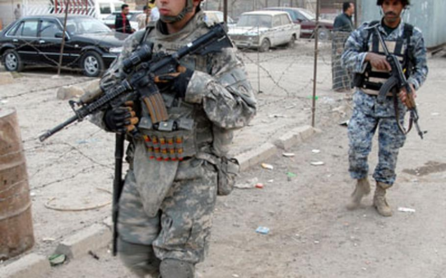 First Platoon, Company F, 2nd Squadron, 2nd Cavalry (Stryker) Regiment soldier Spc. Edward Escamilla, 22, of Mesquite, Texas, left, patrols Saha, Baghdad with an Iraqi National Police officer on Tuesday.