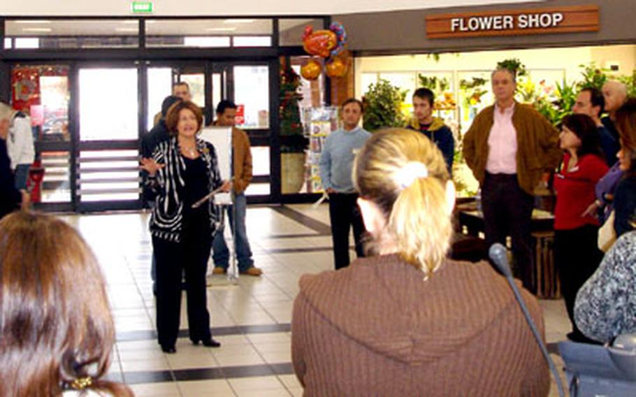 Naples Navy Exchange General Manager Christina Giordano briefs her sales staff before the doors opened to customers for the start of the holiday shopping season the day after Thanksgiving.
