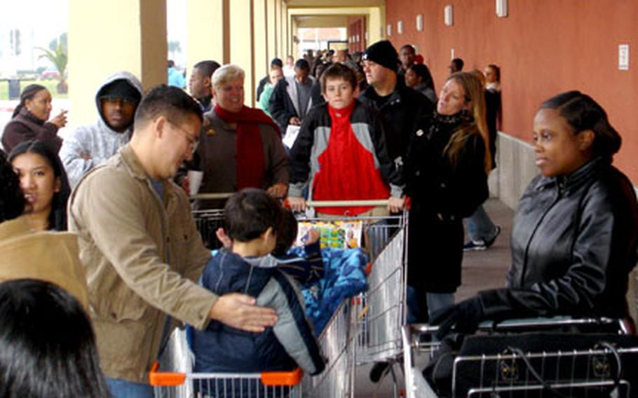 Shoppers line up outside the Navy Exchange in Naples at the Support Site in Gricignano for the start of the holiday shopping season.