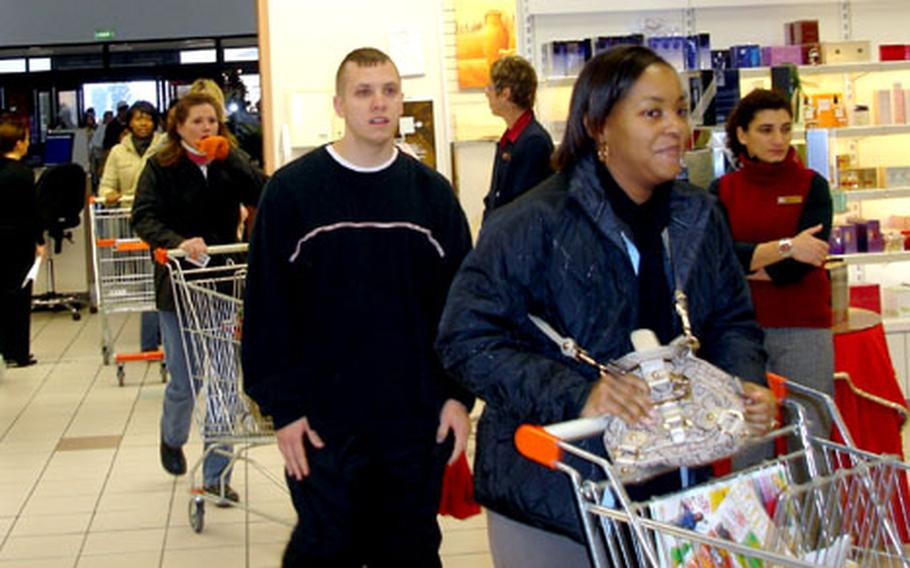 Shoppers quickly file into the Navy Exchange in Naples for the start of the holiday shopping season.