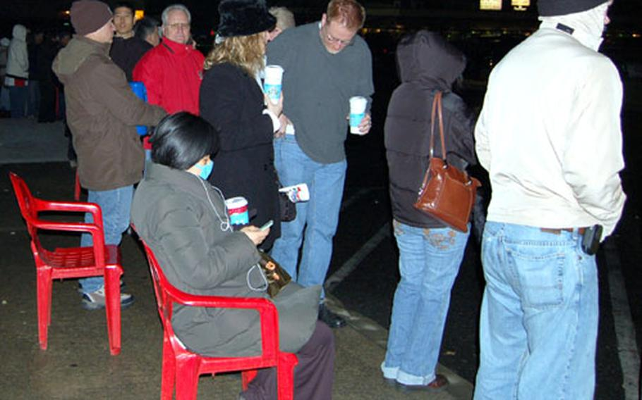 Customers stand in the cold in the early hours of Black Friday waiting for the Yongsan Garrison Post Exchange to open.