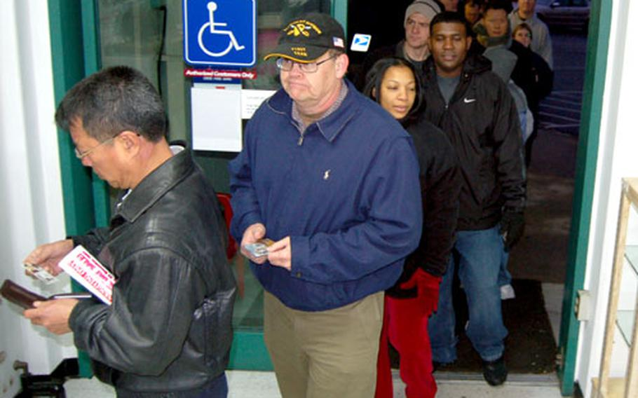 Customers file into the Yongsan Garrison Post Exchange. Many of them had been waiting in line more than four hours hoping to take advantage of the sales and giveaways available.