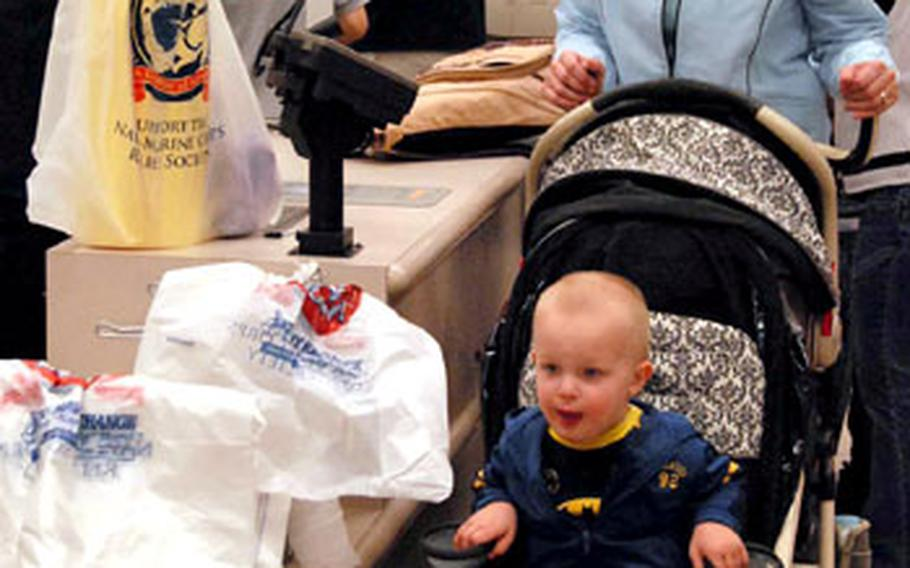Petty Officer 1st Class Margaret Jackson checks out with items for her son at the Navy Exchange at Sasebo Naval Base.
