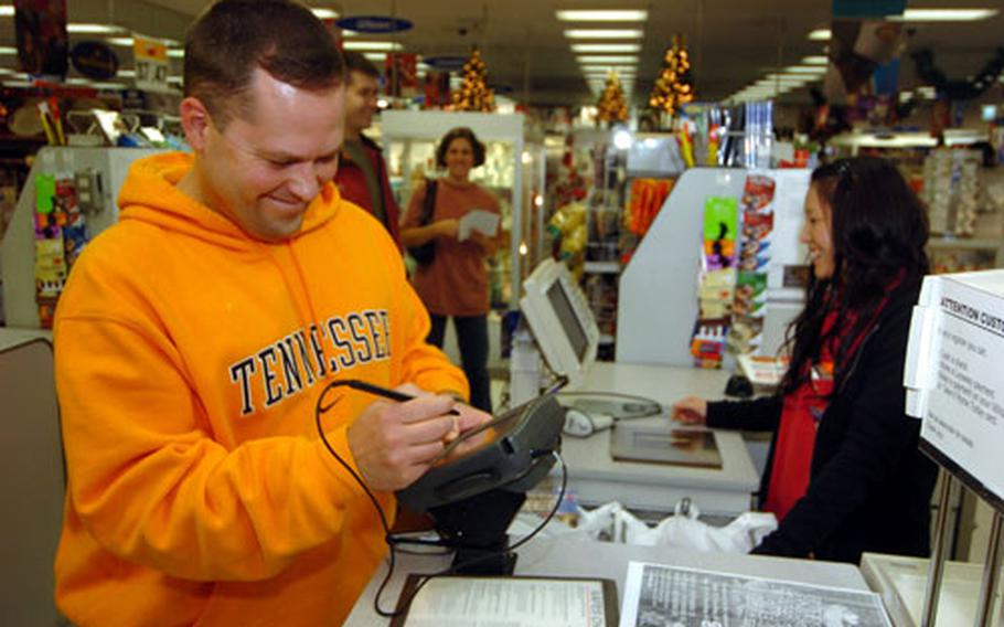 Holiday shopping for servicemembers in Japan is a little harder this year because the dollar's value has dropped against the yen. On Friday, Capt. William Carpenter chose to shop at the Post Exchange at Camp Zama. Other servicemembers said they feel a crunch this year because their cost-of-living allowance hasn't changed to reflect the weaker dollar.