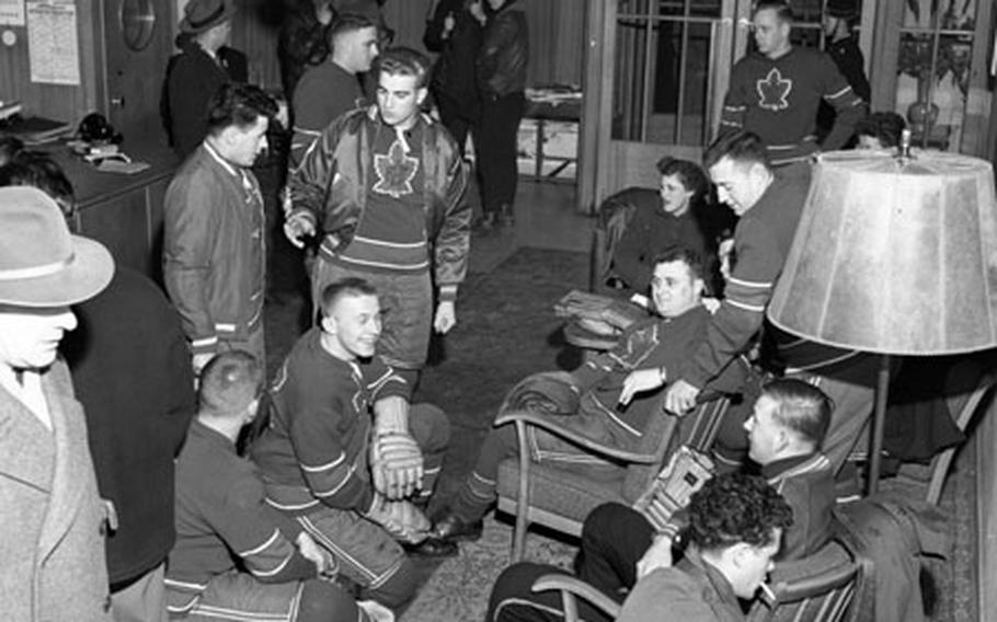 Players from the Canadian Flyers hockey team wait in a German hotel lobby before leaving for the rink in 1954.