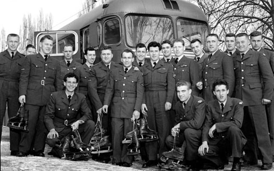 The Canadian Fliers pose in front of their team bus.