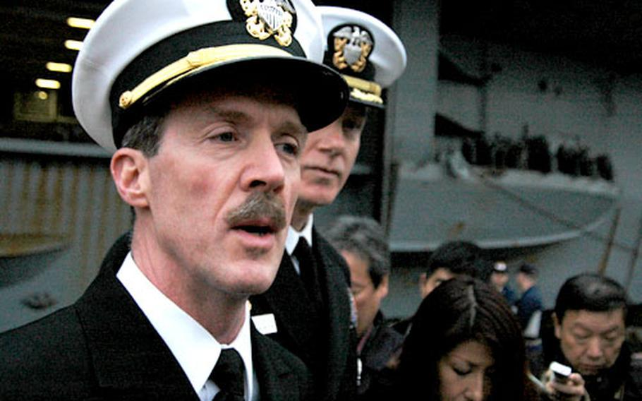 Rear Adm. Rick Wren, left, Commander Task Force 70, and Kitty Hawk's commanding officer, Todd Zecchin, lauded the crew's many achievements and answered questions about the ill-fated Hong Kong port visit.