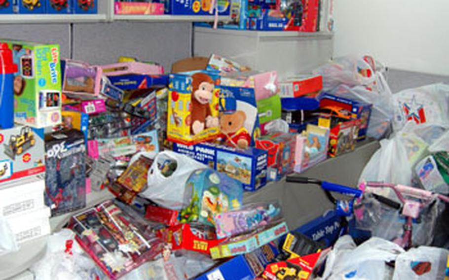 Piles of toys fill a small cubicle at the Marine Forces Korea headquarters building on Yongsan Garrison, South Korea. The toys were collected for the Toys for Tots program, which provides Christmas gifts to disadvantaged children.