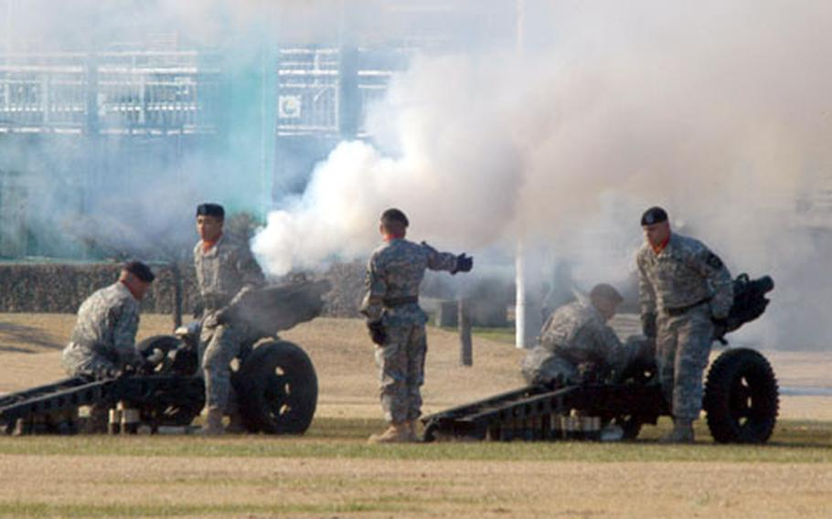 Members of the 1st Battalion, 15th Field Artillery Regiment's salute battery fire cannons during the 2nd Infantry Division change of command ceremony Wednesday at Camp Casey.
