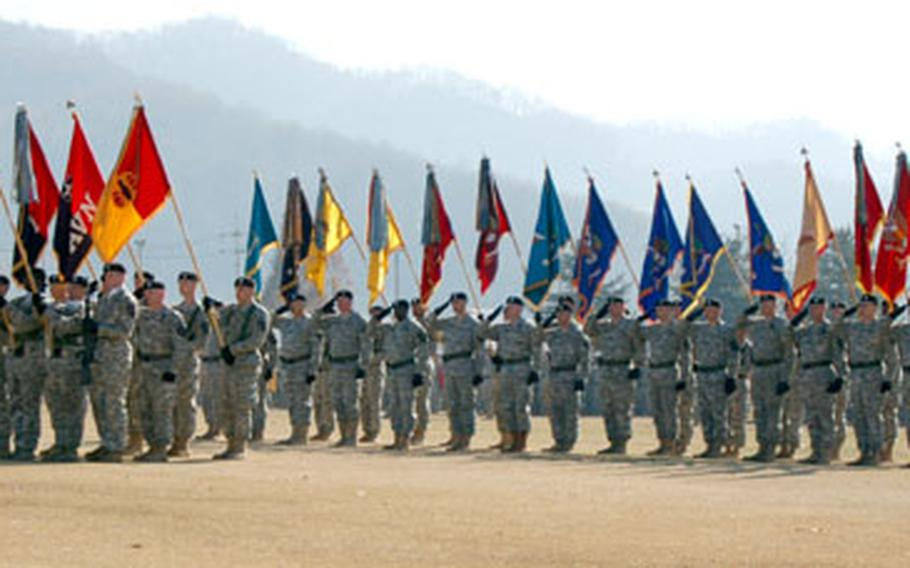 Units from the 2nd Infantry Division display their colors during the 2nd ID change of command ceremony Wednesday at Camp Casey.