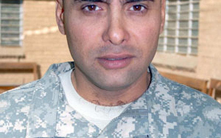 Cpl. Aawss Zahed, 30, of Mosul, Iraq, is one of fewer than 20 Iraqis serving with the U.S. Army in Iraq.