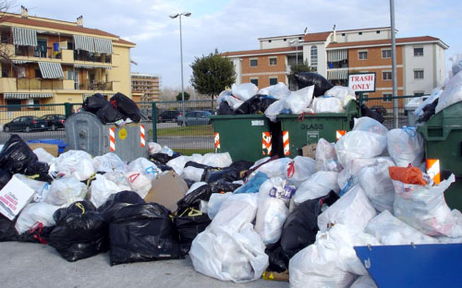 Trash piles up at a collection site in one of the housing areas on the Navy Support Site at Gricignano in Naples, Italy.