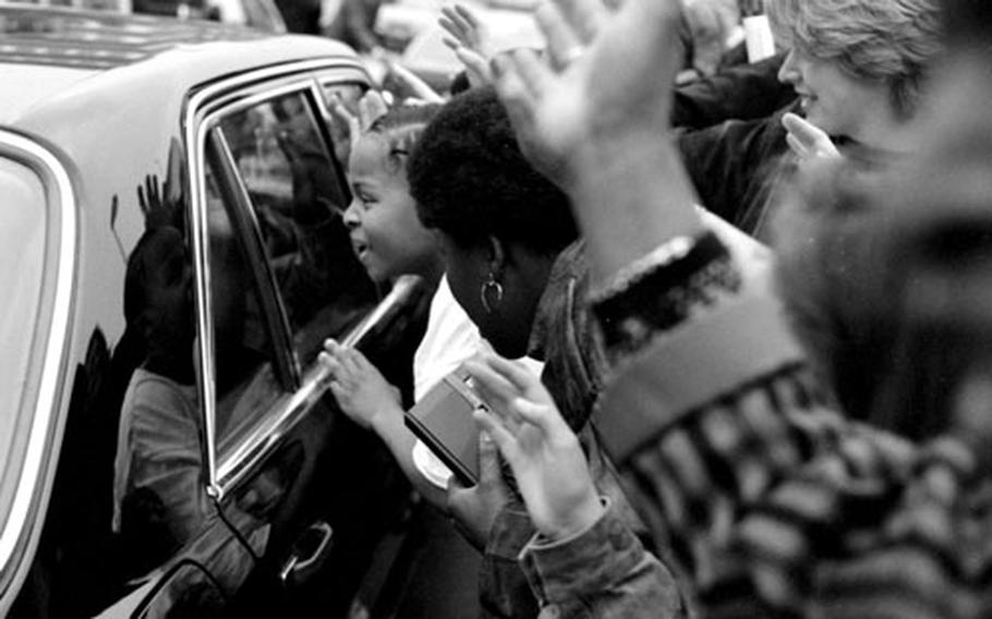 Nelson Mandela's supporters crowd around his car.
