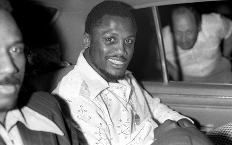 Heavyweight boxing champion Joe Frazier arrives in Frankfurt to begin a tour of Europe with his blues-rock group, The Knockouts.