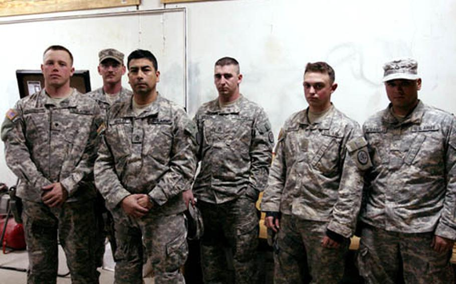 Soldiers from Crazyhorse Troop, 1st Squadron, 3rd Armored Cavalry Regiment and Iraqi police killed Noman Jawar Deahim, their top high-value target, and another insurgent during a firefight Jan. 16 that lasted more than three hours. The soldiers pictured here took part in the gunbattle. Shown from left are: Spc. Michael Jacobson, 24, of Janesville, Wis.; Sgt. 1st Class Jonathan Mullins, 36, of Charleston, W.Va.; Staff Sgt. Ron Aguilar, 39, of Midland, Texas; Staff Sgt. Gene Spears, 28, of Panama City, Fla.; Pvt. John Barrett, 20, of Manchester, England and Spc. Patrick Modarelli, 25, of Raleigh, N.C.