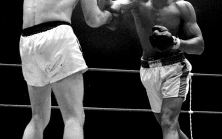 Muhammad Ali lands a right to the head of Karl Mildenberger, moments before referee Teddy Waltham stops the fight in the 12th round on September 10, 1966.