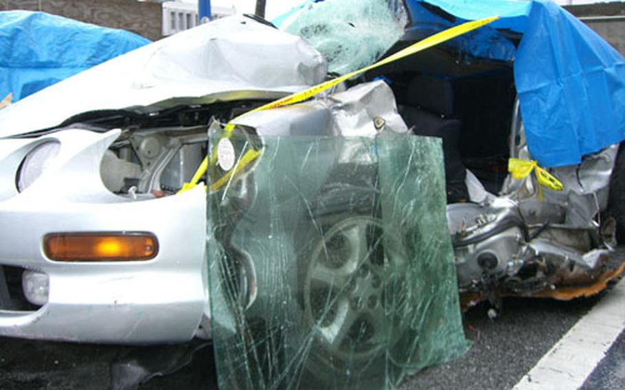 The car driven by James Yeakey is seen here after the head-on collision on Highway 330 in Kitanakagususku, Okinawa.