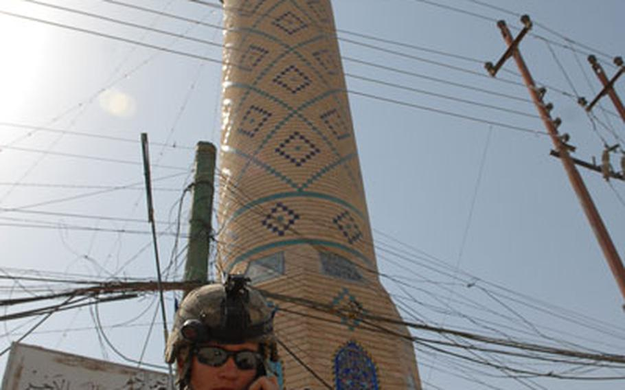 Spc. Stephen Neff, 23, of Mesa, Ariz., checks in on the radio during a patrol Sunday in the Saydiyah area of Baghdad.