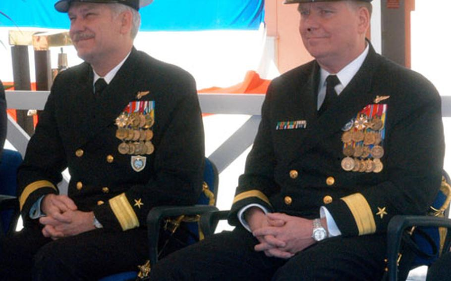 Outgoing Rear Adm. Michael R. Groothousen, left, and incoming Rear Adm. David J. Mercer at a change-of-command ceremony Monday in Naples. Mercer came to Italy from Washington.