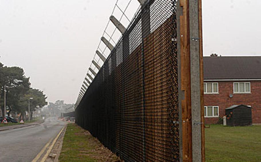 This security fence along Radcliffe Road will become part of RAF Lakenheath's perimeter fence when the base's new Gate 2 opens on May 31. The other side of the road, where Anglo Housing sits, will become off-base property with the move.