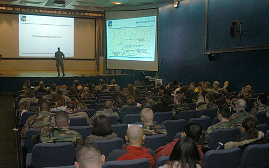 Residents of Newmarket's Studlands Park leased housing listen to a town hall briefing inside the RAF Lakenheath theater last week.