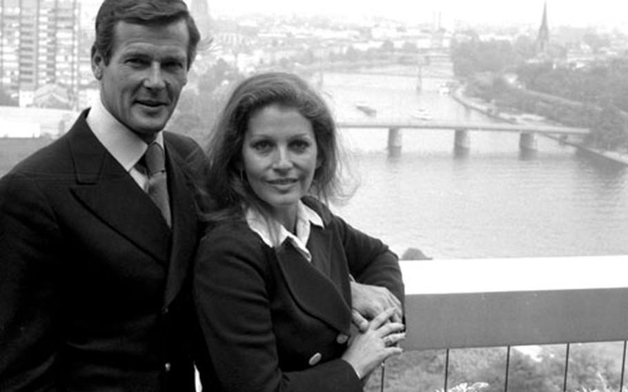 Roger Moore and his wife, Italian actress Luisa Mattioli, meet the press in Frankfurt in 1974.