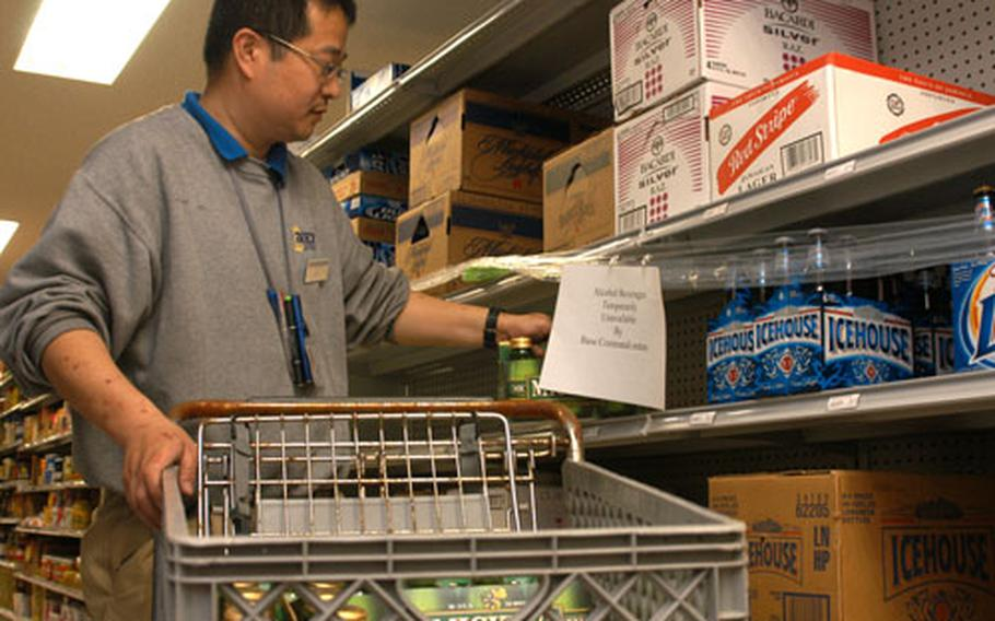 Yokosuka Navy Exchange employees emptied the shelves of alcohol Wednesday evening when orders came down prohibiting the sale of alcohol on base and all public consumption of alcohol by Status of Forces Agreement personnel attached to Yokosuka, Ikego and Negishi. A 10 p.m. to 6 a.m. curfew also went into effect. The restrictions will be reviewed Monday, officials said.