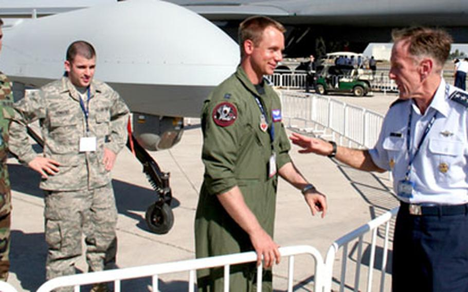 Gen. Norman Seip, commander of Air Forces Southern Command, greets airmen guarding a Predator unmanned aerial vehicle during Wednesday events at the FIDAE air show in Santiago, Chile.