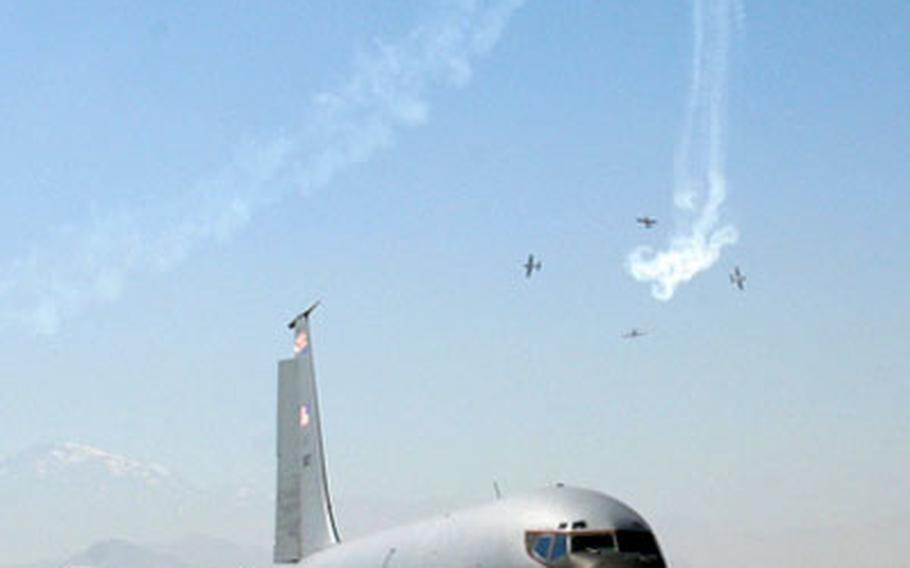 Chilean jets perform stunts above a U.S. KC-135 cargo jet during Tuesday's performances at the FIDAE air show in Santiago.