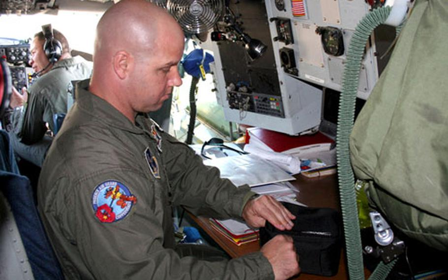 Boom Operator Tech. Sgt. Tony Graziani, from Phoenix-based 161st Air Refueling Wing prepares for takeoff on Wednesday.