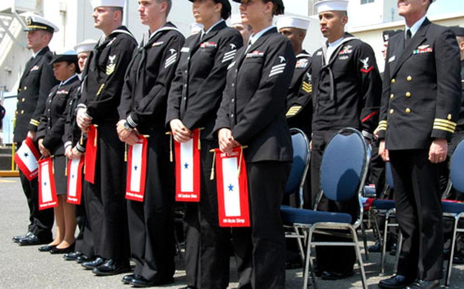 Each sailor was presented with a customized blue star service flag to commemorate their service.